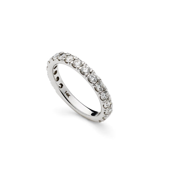 An image of a Virani Jewelers 14K white gold wedding ring standing up on its side. | Surprise your love with a beautiful white gold diamond wedding ring from Virani Jewelers.  Diamon...