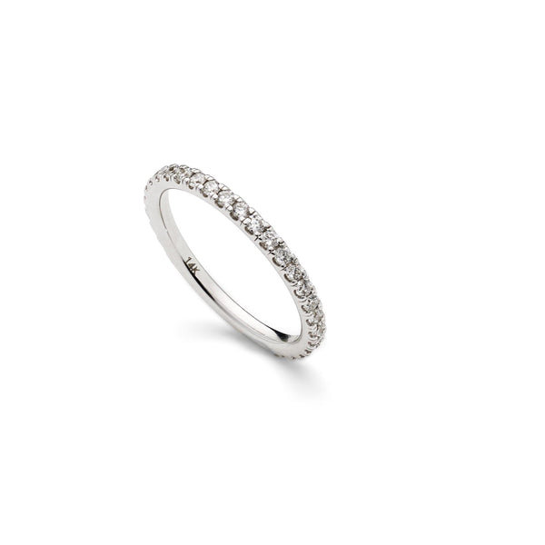 An image featuring the side view of a Virani Jewelers' 14K white gold wedding ring. | Create the perfect bridal set with a 14K white gold wedding ring from Virani Jewelers!  Each diam...