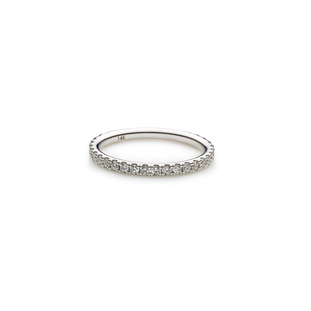 An image of a thin 14K white gold wedding ring from Virani Jewelers. | Create the perfect bridal set with a 14K white gold wedding ring from Virani Jewelers!  Each diam...