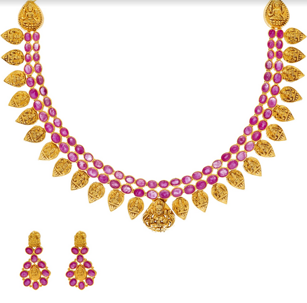 An image of the 22K gold necklace set with ruby embellishments from Virani Jewelers. | Celebrate your culture in style with a beautiful 22K gold necklace set from Virani Jewelers!  Des...