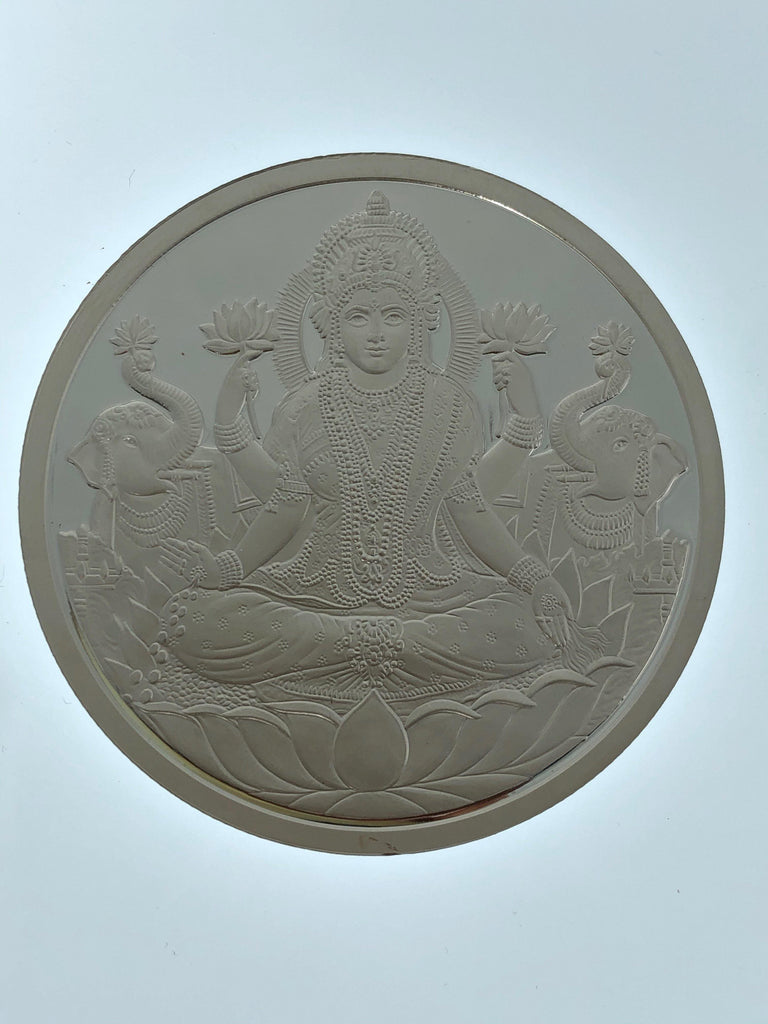 Laxmi Silver Coin with OM engraved on the back, 100 grams | Laxmi Silver Coin with OM engraved on the back, 100 grams silver weight.