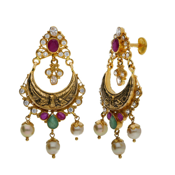 A side view of a pair of elegant earrings in an Indian jewelry set from Virani Jewelers | Use this 22K yellow gold set from Virani Jewelers to accessorize with elegance!  Includes convert...