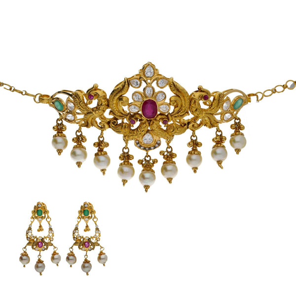 An image of an elegant 22K yellow gold jewelry set from Virani Jewelers | Looking for elegant 22K yellow gold jewelry to accompany your traditional attire? This versatile ...