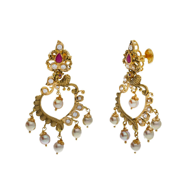A close-up, side view of a pair of earrings in an Indian jewelry set from Virani Jewelers | Accessorize elegantly with this 22K yellow gold necklace and earring set from Virani Jewelers!  M...
