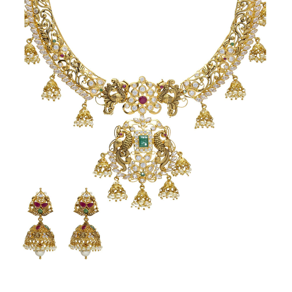 22K Yellow Antique Gold Necklace & Jhumki Earrings Set W/ Jhumki Charms, Peacock Accents, Pearls, Rubies, Emeralds & Pachi CZ |    Make a statement with your jewelry in unmatched gold and gemstone designs like this 22K yellow...