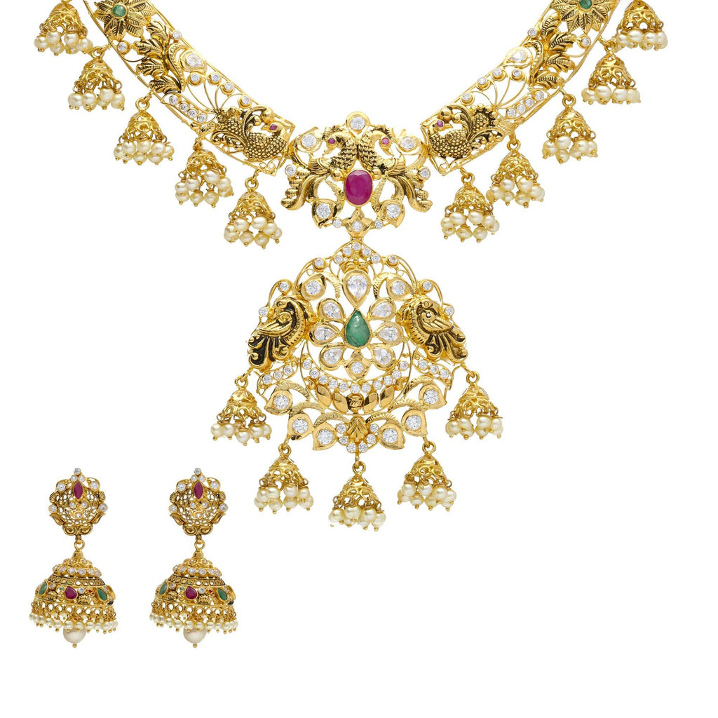 An image of a lustrous 22K gold jewelry set from Virani Jewelers | Introduce your wardrobe to 22K yellow gold jewelry with this exquisite set from Virani Jewelers! ...