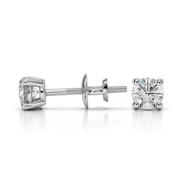 14k White Gold Round Cut Diamond Solitaire Earrings | A beautiful pair of Solitaire Diamond Studs. Total weight of 1.0 ct.