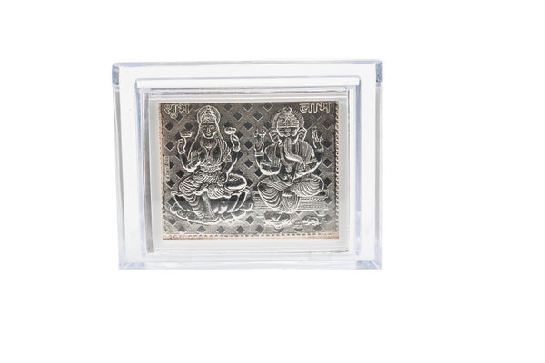Silver Frame with Ganesh and Laxmi | Silver Frame with Deity. Length 4 In Breadth 3 In.