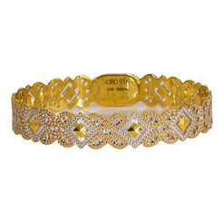One multi-tone 22K gold bangle featuring butterfly and diamond-shaped cut-outs.