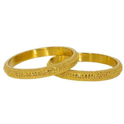 Stunning set of two 22K yellow gold bangles from Virani Jewelers.