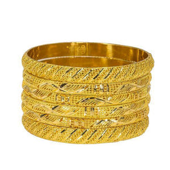 Set of six yellow 22K bangles from Virani Jewelers featuring intricate details.