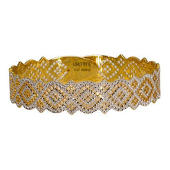 One 22K multi-tone bangle featuring white and gold polka designs and expert attention to detail.