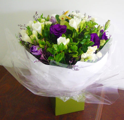 Hand tied posy of freesias and lisianthus
