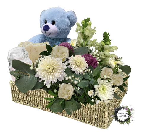 Flower basket with teddy bear, soap and candle for baby boy