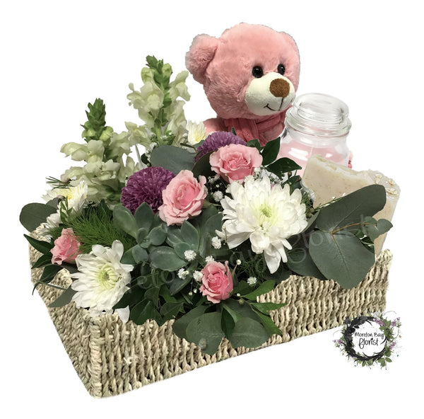 Baby girl flowers with teddy bear, soap and candle.