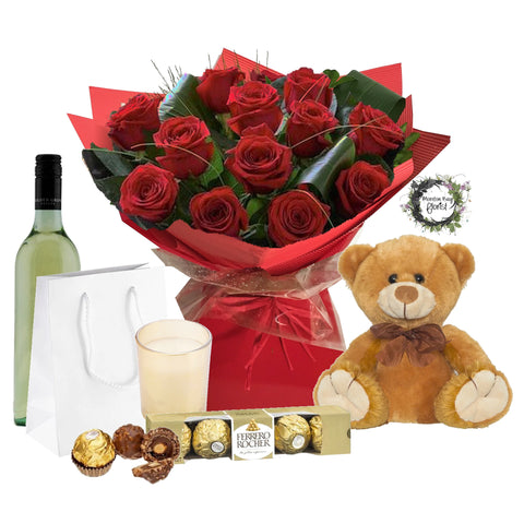 Dozen long stemmed red roses, teddy, candle, chocolates and wine