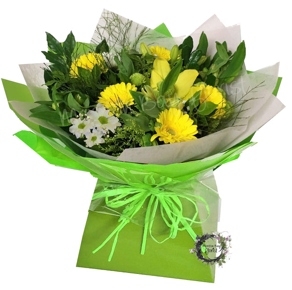 Bouquet of yellow flowers in aquabox