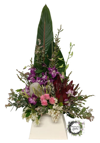 Premium flower arrangement with orchids, roses and natives