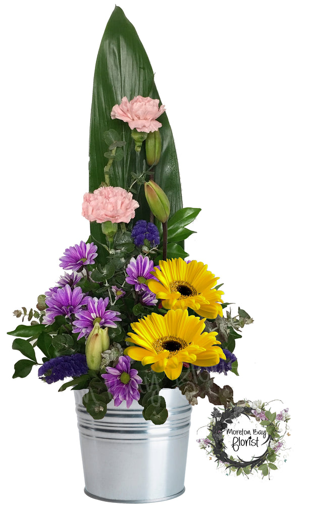 Flower arrangement in tin bucket