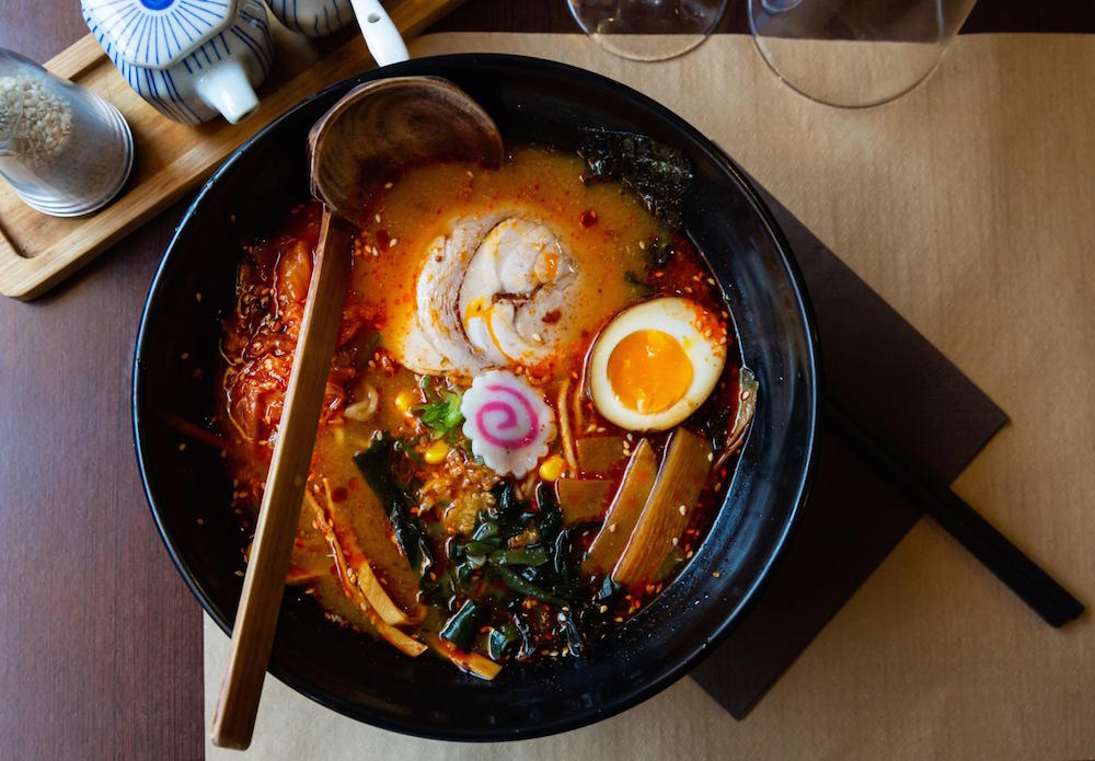 Bowl of ramen with wooden spoon