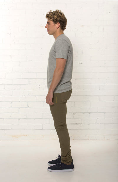 Side view of men's organic Khaki denim jean by TRi COLOUR FEDERATiON