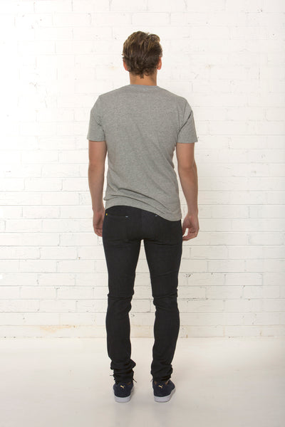 Back side of dark blue organic denim jean by TRi COLOUR FEDERATiON