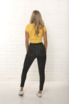 Back view of women's high waisted organic dark blue jean by TRi COLOUR FEDERATiON