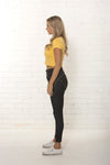 Side view of women's high waisted organic dark blue jean by TRi COLOUR FEDERATiON