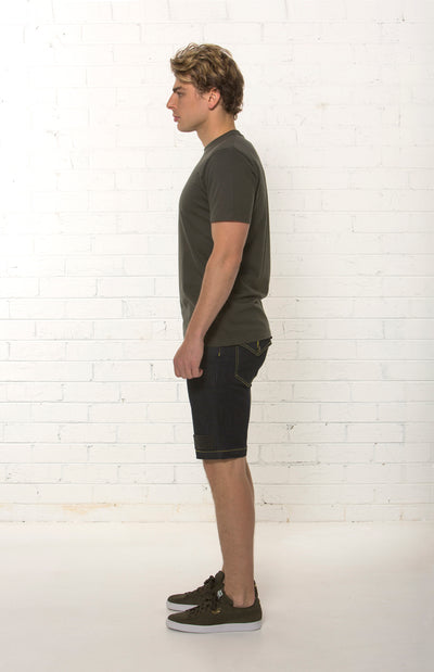 Side view of men's mid rise organic dark blue denim short by TRi COLOUR FEDERATiON