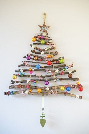Bohemian inspired Christmas tree made from wood and lights