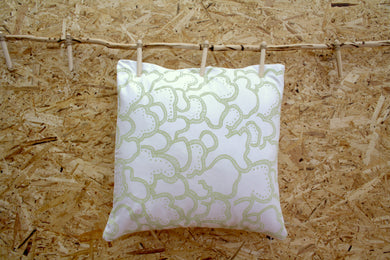 White cushion with celery green mushroom design