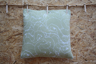 Celery green cushion with white mushroom print