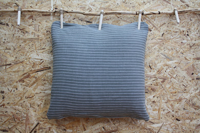 Olive green cushion with woven stripe