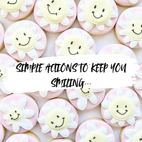 Smiley Daisies background for slogan simple actions to keep you smiling