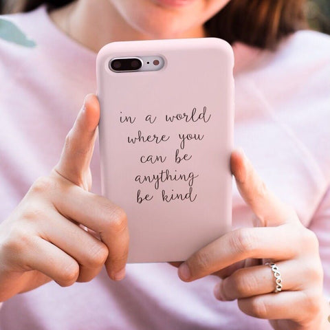 Coconut Lane Be Kind Phone Case held by girl in pink jumper