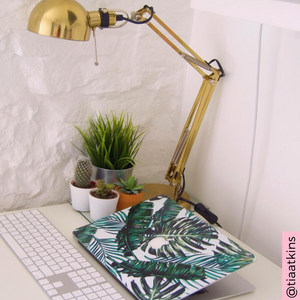 Coconut Lane's Palm Macbook Skin by influencer @tiaatkins