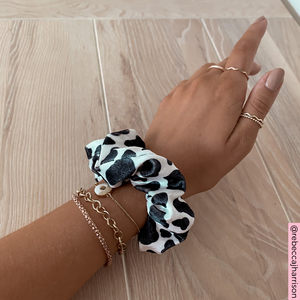@rebeccajharrison wearing Cow Print Scrunchie on wrist