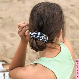 @anya_and_ali modelling Cow Print Scrunchie on beach in green top