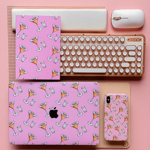 Coconut Lane's Passion Fruit Martini Macbook Skin with matching Phone Case and Notebook