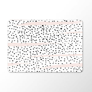 black and white dalmatian print with pink brush strokes on a macbook with white background