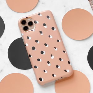 Nude Spots Phone Case on white surrounded by spots