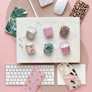 Coconut Lane's six Airpod cases with matching phone cases on pink background