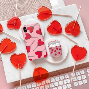 Candy Hearts Phone Case and Airpods Case surrounded by candy hearts