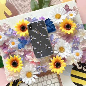 Bee Clear Phone Case surrounded by flowers and bees