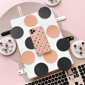 Nude Spots Phone Case on pink background surrounded by spots