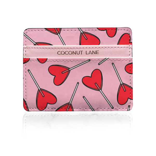 pink leather card holder with red candy heart design on white background