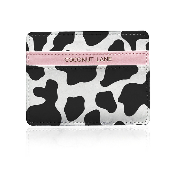 black and white cow print leather card holder on white background