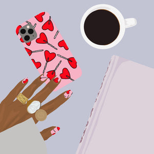 Illustration of Candy Hearts Phone Case on desk with matching nails