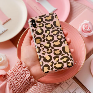 hand holding gold and black leopard print phone case
