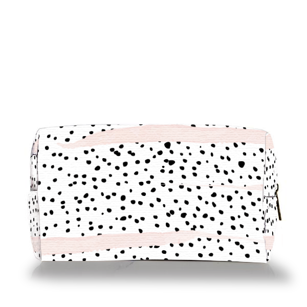 black and white polka dot dalmatian print with pink brush strokes make up bag on white background